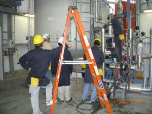 Field Engineer Instructing Personnel